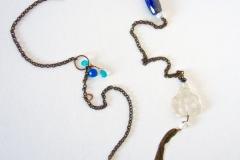 catena e pietre dure blu con pendente budda in cristallo di rocca
