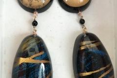 resine fatte a mano con inserzioni pittoriche e pietre dure , chiusura in argento brunito