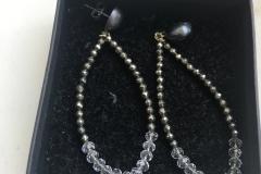 argento brunito, cristalli e metallo